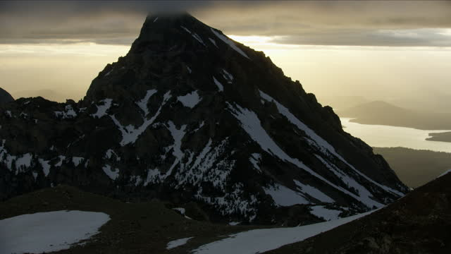 aerial sunrise view mount moran jackson lake wyoming - mt moran stock videos & royalty-free footage