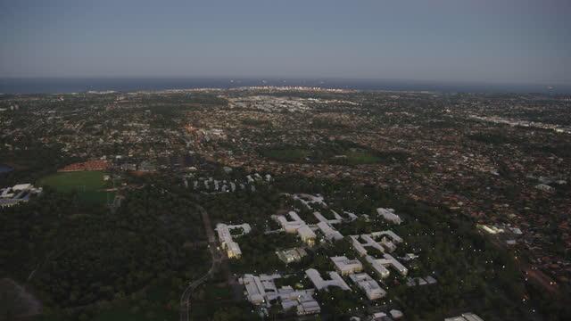 aerial sunrise view murdoch university perth residential suburbs - フリーマントル点の映像素材/bロール