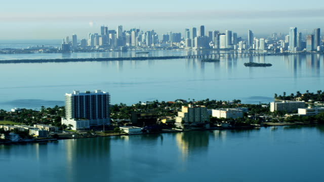 aerial sunrise view north bay island causeway miami - biscayne bay stock-videos und b-roll-filmmaterial