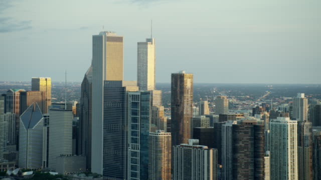 aerial sunrise view of chicago city skyscrapers - one prudential plaza stock videos & royalty-free footage