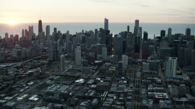 aerial sunrise view of chicago illinois cityscape - aerial transport building stock videos & royalty-free footage