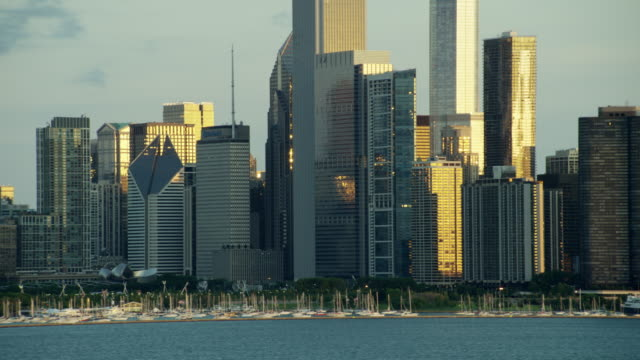 aerial sunrise view of chicago waterfront skyscrapers - one prudential plaza stock videos & royalty-free footage