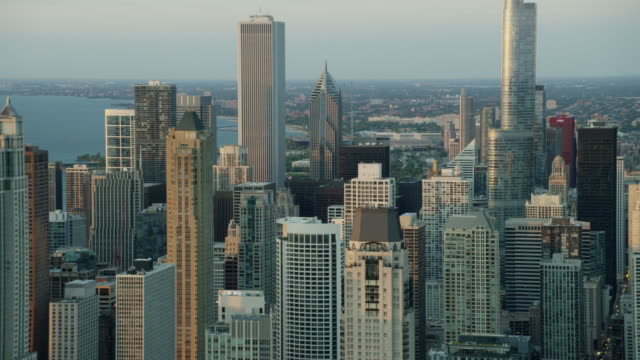 aerial sunrise view of downtown skyscraper buildings chicago - two prudential plaza stock videos & royalty-free footage