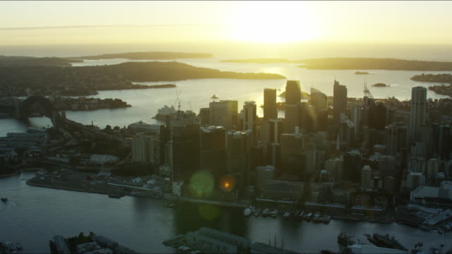 aerial sunrise view of downtown skyscrapers and sydney - ferry stock videos & royalty-free footage