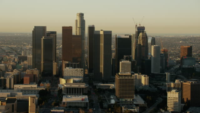 aerial sunrise view of los angeles financial district - financial building stock videos & royalty-free footage