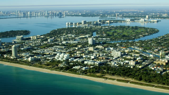 aerial sunrise view of normandy shores condominiums miami - biscayne bay stock videos & royalty-free footage