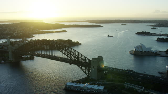 aerial sunrise view of sydney harbor bridge australia - opera house stock videos & royalty-free footage