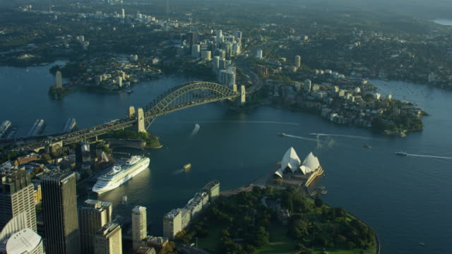 aerial sunrise view of sydney harbor bridge - sydney australia stock videos and b-roll footage