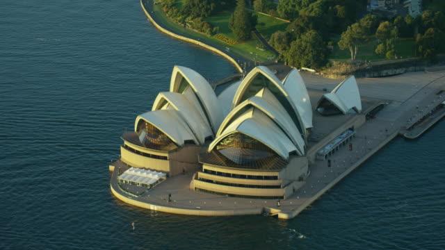aerial sunrise view of sydney opera house australia - concert hall stock videos & royalty-free footage