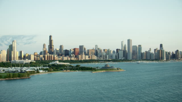 aerial sunrise view of waterfront skyline chicago illinois - shedd aquarium stock videos and b-roll footage
