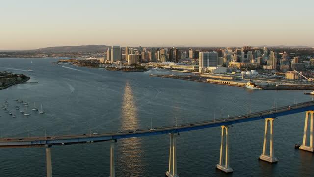 aerial sunrise view san diego bay coronado bridge - san diego stock videos & royalty-free footage