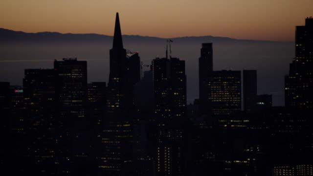 Aerial sunrise view San Francisco Bay Bridge skyscrapers