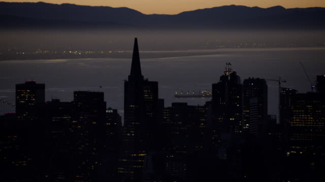 aerial sunrise view san francisco illuminated city skyscrapers - oakland california stock videos & royalty-free footage