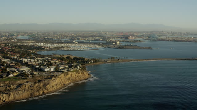 aerial sunrise view terminal island los angeles coast - aerial transport building stock videos & royalty-free footage