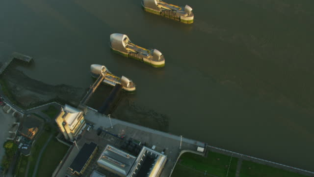 aerial sunrise view thames barrier flood defence london - fluss themse stock-videos und b-roll-filmmaterial