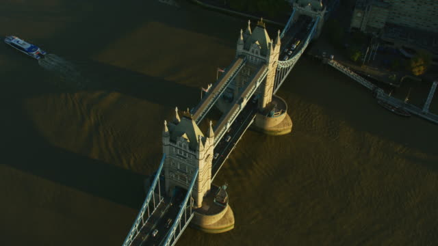 Aerial sunrise view Tower Bridge commuter travel London