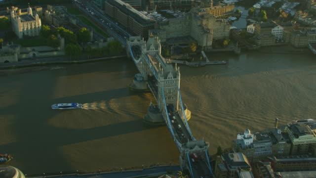 aerial sunrise view vehicles crossing tower bridge london - bascule bridge stock videos and b-roll footage