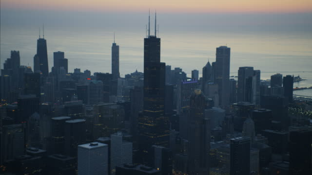 aerial sunrise view willis tower skyscraper building chicago - willis tower stock videos and b-roll footage