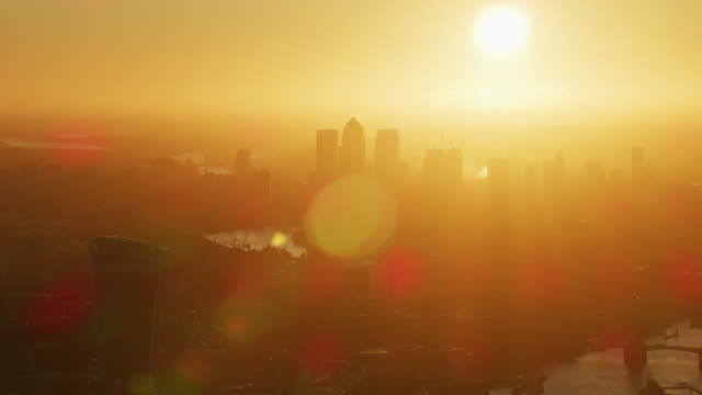 aerial sunrise view with sun flare london skyline - river thames stock videos & royalty-free footage