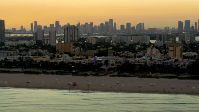 aerial sunset art deco hotels south beach miami - bay of water stock videos & royalty-free footage