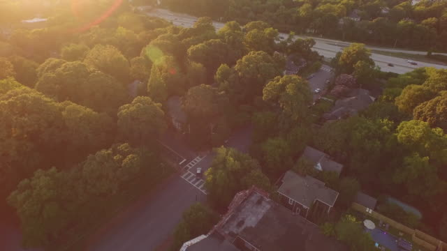 4k aerial sunset city reveal - drone aerial video city views in 4k beautiful reveal with traffic and homes in view - georgia bildbanksvideor och videomaterial från bakom kulisserna