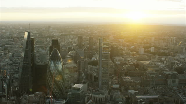 aerial sunset cityscape skyscraper view of london uk - swiss re stock videos & royalty-free footage