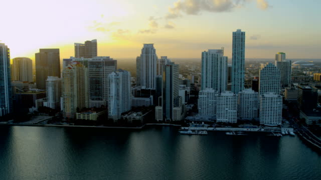 aerial sunset downtown city financial district skyscrapers miami - biscayne bay stock videos and b-roll footage