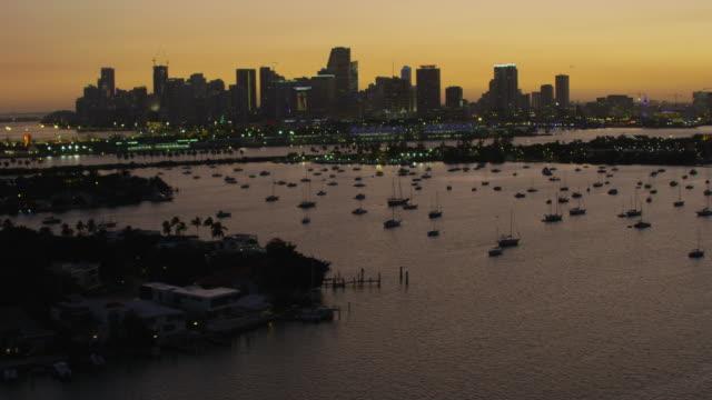aerial sunset illuminated city skyscrapers macarthur vehicle causeway - miami stock videos & royalty-free footage