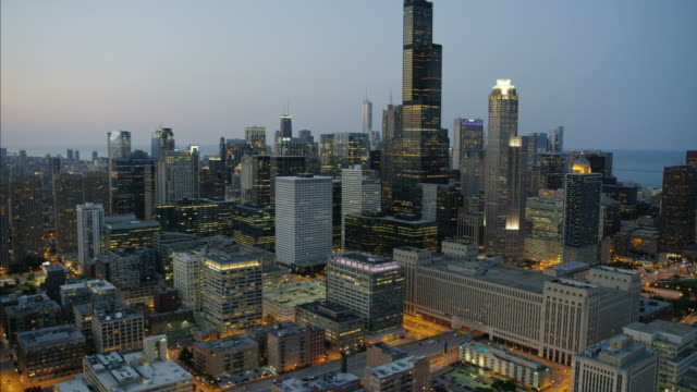 aerial sunset illuminated view lake michigan chicago - willis tower stock videos and b-roll footage
