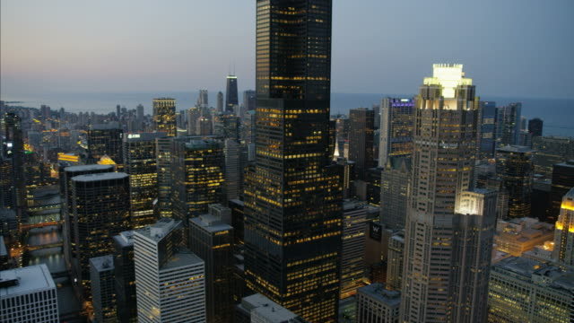 aerial sunset illuminated view lake michigan chicago - willis tower stock videos & royalty-free footage