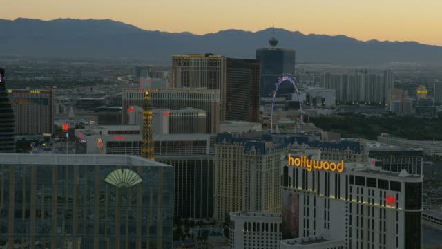 aerial sunset illuminated view resort casinos las vegas - casino stock videos & royalty-free footage