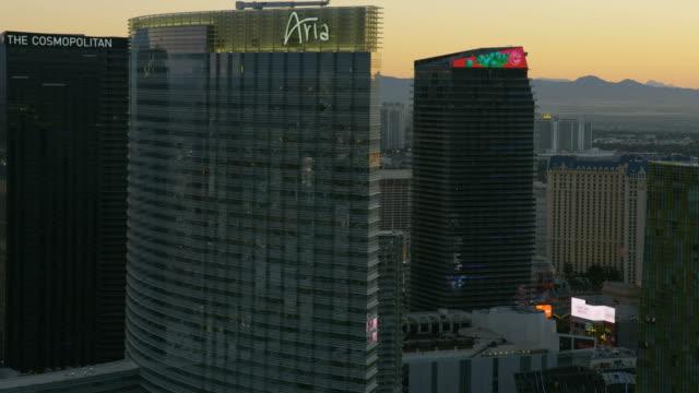 aerial sunset illuminated view resort hotels las vegas - casino stock videos & royalty-free footage