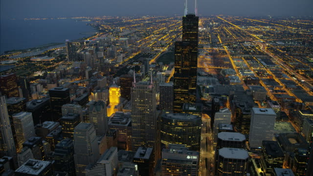 aerial sunset illuminated view sears tower chicago waterfront - willis tower stock videos and b-roll footage