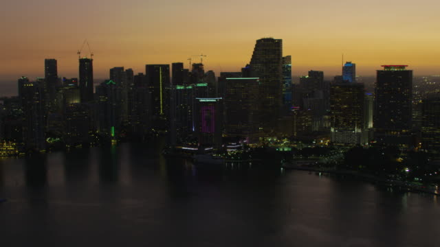 aerial sunset macarthur causeway and cruise terminal miami - biscayne bay stock videos and b-roll footage