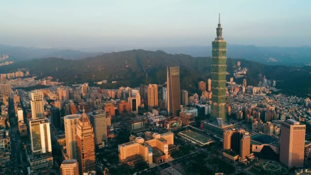 aerial sunset of cityscape at taipei center district, taiwan - taipei 101 stock videos & royalty-free footage