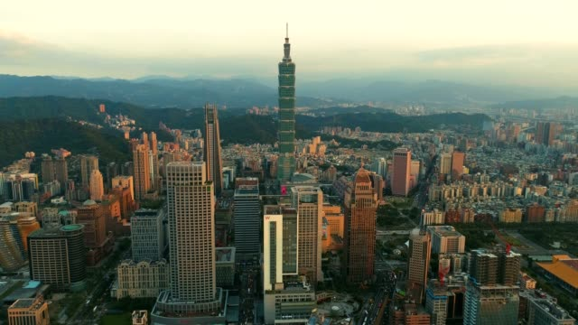aerial sunset of cityscape at taipei center district, taiwan - taipei 101 stock videos and b-roll footage