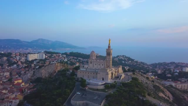 aerial sunset of notre-dame de la garde, marseille - notre dame de la garde marseille stock videos and b-roll footage