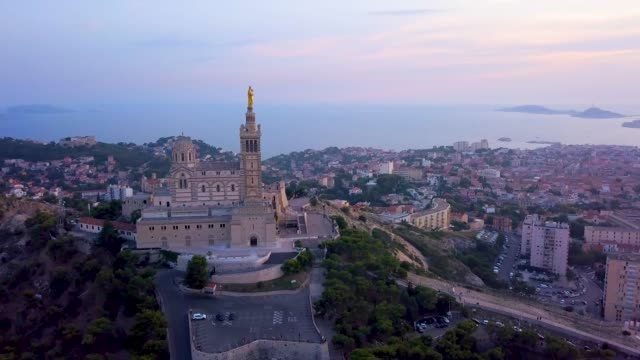 aerial sunset of notre-dame de la garde - real time stock videos & royalty-free footage