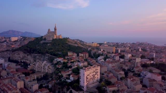 aerial sunset of notre-dame de la garde - notre dame de la garde marseille stock videos and b-roll footage