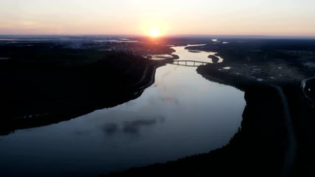 Aerial sunset over Athabasca river bridge Alberta Canada