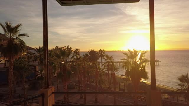 aerial, sunset over coastal resort in mexico - baja california peninsula stock videos & royalty-free footage