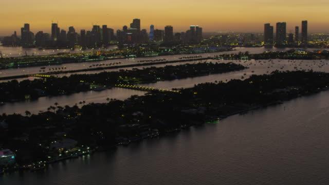 stockvideo's en b-roll-footage met aerial sunset palm islands biscayne bay coastline miami - biscayne bay
