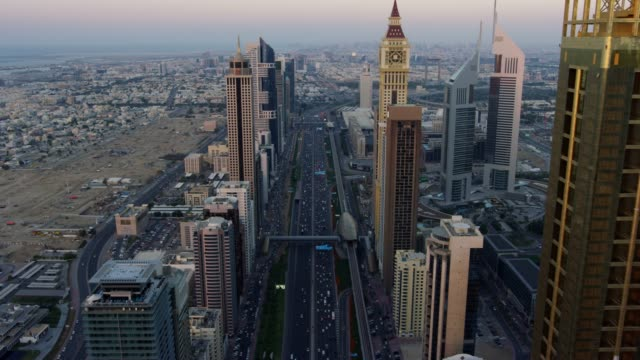 stockvideo's en b-roll-footage met aerial sunset sheikh zayed road city skyscrapers dubai - perzische golf