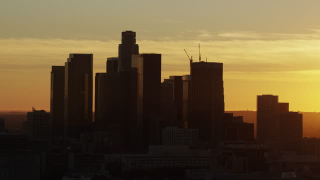 Aerial sunset silhouette view Los Angeles cityscape California