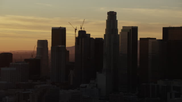 aerial sunset silhouette view los angeles cityscape california - financial building stock videos & royalty-free footage