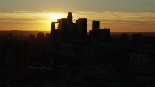 Aerial sunset silhouette view of Los Angeles cityscape