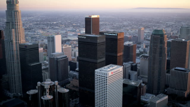 aerial sunset skyline view skyscrapers downtown los angeles - tower stock videos & royalty-free footage