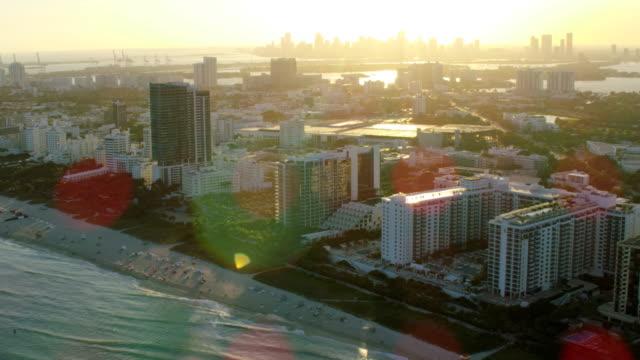 aerial sunset south beach boardwalk condominium resort miami - miami beach stock videos & royalty-free footage
