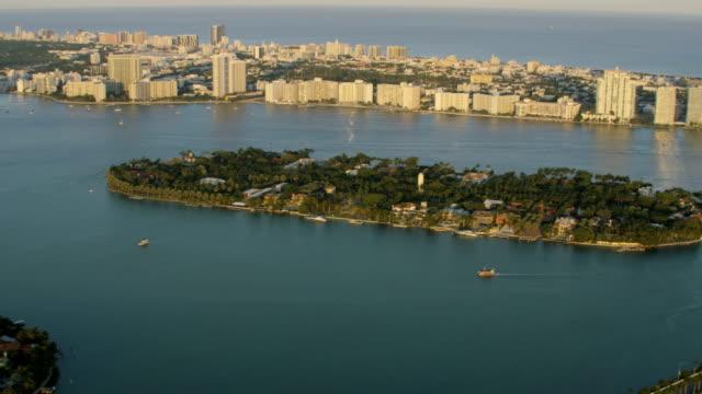 aerial sunset star island macarthur causeway condominiums florida - star island stock videos & royalty-free footage