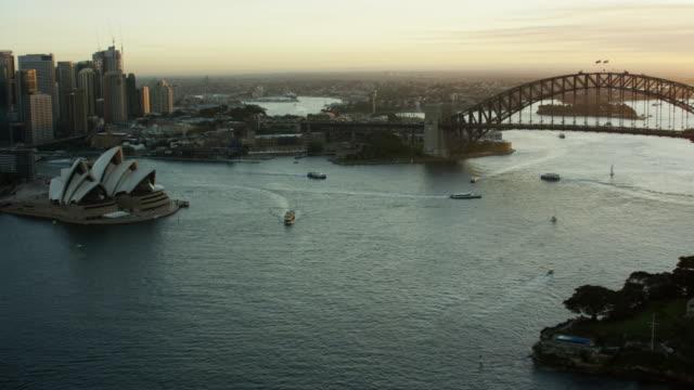 Aerial sunset Sydney Harbor Bridge and Opera House